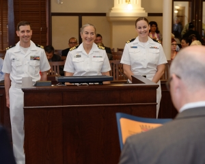 160419-N-NW169-006 SAN ANTONIO (April 19, 2016) Capt. Elizabeth Montcalm-Smith, Commander, Naval Medical Research Unit - San Antonio, center, Lt Jason Fischer, assigned to Navy Office of Community Outreach, left, and Lt Kathryn Gray, assigned to Navy Office of Community Outreach, right, accepts an official proclamation of Navy Week from Bexar County Commissioners Court. Navy Week San Antonio coincides with Fiesta San Antonio which started in 1891 to honor the memory of the heroes of the Alamo and the Battle of San Jacinto. The Navy Week program is designed to raise awareness about the Navy in areas across the country that traditionally do not have a naval presence, and to bring America's Navy closer to the people it protects through community relations projects, speaking engagements, science, technology, engineering, mathematics (STEM) demonstrations and media interviews with flag hosts and local area Sailors. (U.S. Navy photo by Chief Mass Communication Specialist Michael O'Day/Released)