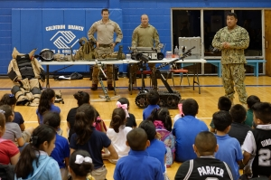 160419-N-NW169-044 SAN ANTONIO (April 19, 2016) Children at the Boys & Girls Clubs of San Antonio watch a demonstration at the Navy Explosive Ordnance Disposal discovery table hosted by Senior Chief Explosive Ordnance Disposal Technician Dominic Juarez, right, Explosive Ordnance Disposal Technician 2nd Class Seth Willey, center, and Explosive Ordnance Disposal Technician 2nd Class Kit Wingate, left, assigned to Explosive Ordnance Disposal Mobile Unit (EODMU) 11, during San Antonio's Navy Week. The Navy Week program is designed to raise awareness about the Navy in areas across the country that traditionally do not have a naval presence, and to bring America's Navy closer to the people it protects through community relations projects, speaking engagements, science, technology, engineering, mathematics (STEM) demonstrations and media interviews with flag hosts and local area Sailors. (U.S. Navy photo by Chief Mass Communication Specialist Michael O'Day/Released)