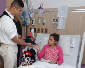 160422-N-NW169-005 SAN ANTONIO (April 22, 2016) Seaman Jaydee Rico, assigned to USS Constitution, presents a Navy command ball cap to a patient at Children's Hospital of San Antonio during a Caps for Kids visit. The Sailors from Old Ironsides are participating in San Antonio's Navy Week. The Navy Week program is designed to raise awareness about the Navy in areas across the country that traditionally do not have a naval presence, and to bring America's Navy closer to the people it protects through community relations projects, speaking engagements, science, technology, engineering, mathematics (STEM) demonstrations and media interviews with flag hosts and local area Sailors. (U.S. Navy photo by Chief Mass Communication Specialist Michael O'Day/Released)