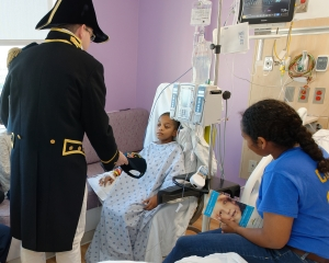 160422-N-NW169-009 SAN ANTONIO (April 22, 2016) Lt. Cmdr. Timothy Anderson, the executive officer of USS Constitution, presents a Navy command ball cap to a patient at Children's Hospital of San Antonio during a Caps for Kids visit. The Sailors from Old Ironsides are participating in San Antonio's Navy Week. The Navy Week program is designed to raise awareness about the Navy in areas across the country that traditionally do not have a naval presence, and to bring America's Navy closer to the people it protects through community relations projects, speaking engagements, science, technology, engineering, mathematics (STEM) demonstrations and media interviews with flag hosts and local area Sailors. (U.S. Navy photo by Chief Mass Communication Specialist Michael O'Day/Released)