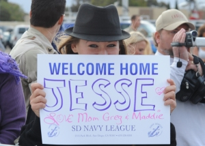 110509-N-NW961-061 SAN DIEGO (May 9, 2011) Families, friends, and fellow Sailors welcome Sailors assigned to Maritime Expeditionary Security Squadron (MSRON) 5, MSRON 9, and MSRON 3 during a welcome home ceremony moments after their Plane landed at Naval Base Coronado. The MSRON detachments are returning from an six month deployment supporting maritime security operations and theater security cooperation efforts in the U.S. 5th Fleet area of responsibility. (U.S. Navy photo by Mass Communication Specialist 1st Class Michael O'Day/Released)